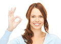 Young woman showing ok sign bright picture of Stock Photo