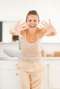 Young woman showing soapy hands happy Stock Photography