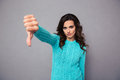 Young woman showing thumb down Royalty Free Stock Photo