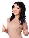 Young woman is showing thumb up gesture Royalty Free Stock Photo