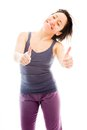 Young woman showing thumbs up sign from both hands adult caucasian isolated on a white background Stock Photo