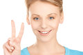 Young woman showing victory or peace sign Royalty Free Stock Photography