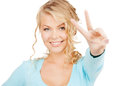 Young woman showing victory or peace sign happy people concept Royalty Free Stock Photography