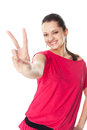 Young woman showing victory sign portrait of pretty smiling in red dress isolated on white background Stock Photography