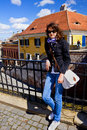 Young woman in sibiu old town center tourist posing near the lies bridge the historic of transylvania romania Royalty Free Stock Image