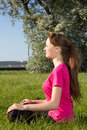 Young woman siiting on the grass in park Royalty Free Stock Photo
