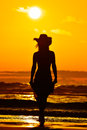 Young woman silhouette on the beach in summer sunset light Royalty Free Stock Photography