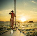 Young woman silhouette at sunrise sailing yacht bow Royalty Free Stock Photo