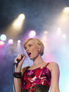 Young woman singing in concert low angle view of a beautiful on stage Stock Images