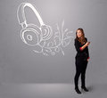 Young woman singing and listening to music with abstract headpho headphone getting out of her mouth Stock Images