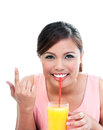 Young woman sipping orange juice portrait of asian with a straw and pointing at copy space over white background Royalty Free Stock Photo