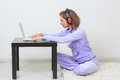Young woman sits on the floor, listening music Royalty Free Stock Photo