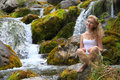 Young woman sits at the river Royalty Free Stock Photos