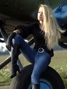 Young woman sitting on airplane landing gear Royalty Free Stock Photo