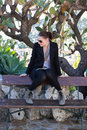 Young woman sitting on a bench Royalty Free Stock Photo