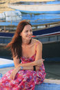 Young woman sitting at boca chica boat pier dominican republic Stock Image