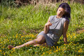 Young Woman Sitting in a Field Royalty Free Stock Photo