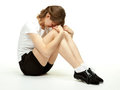 Young woman sitting on the floor in sport clothes Royalty Free Stock Photo