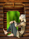 Young woman sitting in the forest house dreaming theme Royalty Free Stock Photos