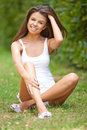 Young woman sitting in the garden Royalty Free Stock Photo