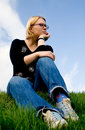 Young woman sitting on the grass Stock Photos