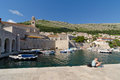 Young woman sitting in the harbor of dubrovnik croatia may croatia on may croatia Royalty Free Stock Image