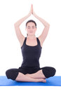 Young woman sitting in lotus position isolated on white background Royalty Free Stock Photos