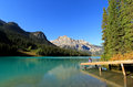 Young woman sitting on a pier at emerald lake yoho national par park british columbia canada Stock Photography