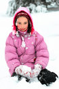 Young woman is sitting in the snow Stock Photography