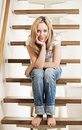 Young woman sitting on steps Royalty Free Stock Photo
