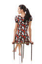 Young woman sitting on stool Royalty Free Stock Photo