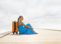 Young woman sitting on wooden pier Royalty Free Stock Photos