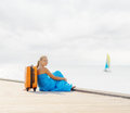 Young woman sitting on wooden pier Royalty Free Stock Image