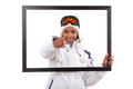 Young woman in ski gears holding a picture frame Royalty Free Stock Image