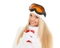 Young woman in ski glasses with red cup and winter warm clothes stands on a white background winter sports Royalty Free Stock Photography