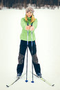 Young woman with ski happy smiling face winter time snow skiing sport and healthy lifestyle concept Royalty Free Stock Images