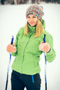 Young woman with ski happy smiling face winter time snow skiing sport and healthy lifestyle concept Royalty Free Stock Photography