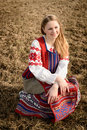 Young woman in slavic belarusian national original suit outdoors a Royalty Free Stock Photography