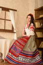 Young woman in slavic belarusian national original suit studio a Royalty Free Stock Image