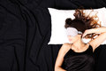 Young woman sleeping with eyeshades a a eye covering mask Stock Image