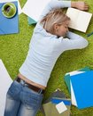 Young woman sleeping on floor. Stock Images