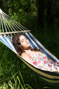 Young woman sleeping in a hammoc hammock garden Royalty Free Stock Photography