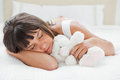 Young woman sleeping with a teddy bear Royalty Free Stock Photography