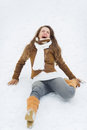 Young woman slipped on snow in winter park Royalty Free Stock Photography