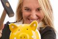 Young woman smashing piggy bank isolated white Royalty Free Stock Photo
