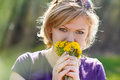 Young woman smell dandelion blonde yellow flower Stock Image