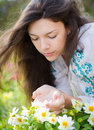 Young woman smelling flowers beautiful yellow in garden Royalty Free Stock Images