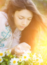 Young woman smelling flowers beautiful yellow in garden with the sunshine Stock Photos