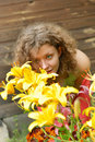 Young woman smelling lilies Royalty Free Stock Photo