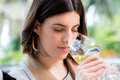 Young woman smelling white wine at tasting. Royalty Free Stock Photo